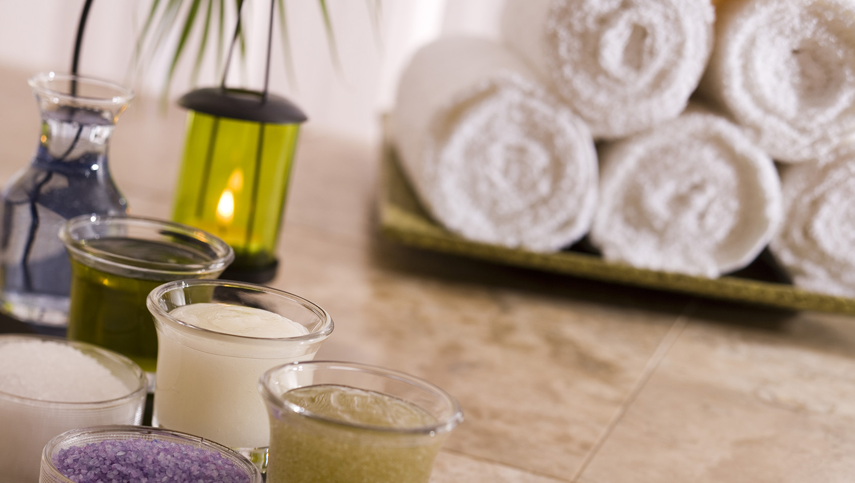 spa candles and towels