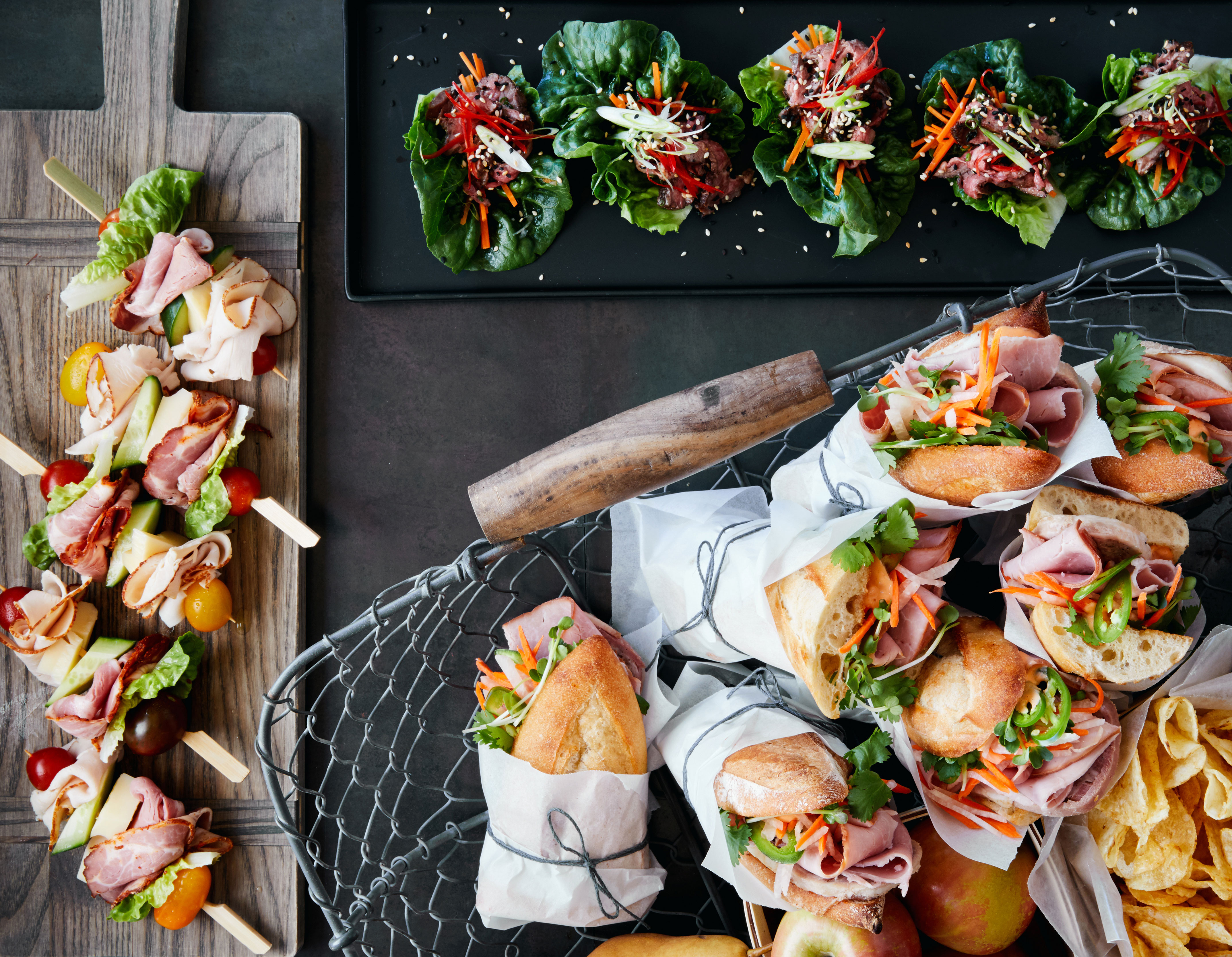 lunch arrangement display with assorted sandwiches